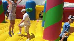 Families Enjoy World's Largest Bounce House [Video]