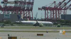 Plane Tire Blows Out, Skids Off Newark Airport Runway [Video]