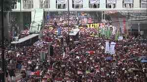 Tens of thousand march in Hong Kong