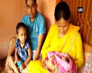Indian Railways TTE helps woman deliver baby on moving train [Video]