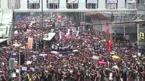 News video: Huge crowds march in Hong Kong, piling pressure on leader