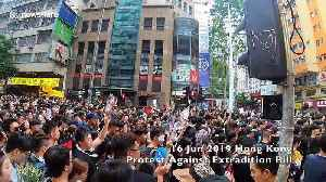 Hong Kong protesters in black shirts shout 'Carrie Lam resign' at third massive demonstration [Video]