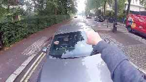 London police arrive at scene after cyclist goes face-to-face with furious driver [Video]