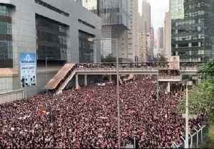 News video: City Leader Issues Apology as Thousands Throng Hong Kong Streets