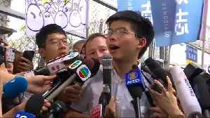 Hong Kong's Joshua Wong walks free, vows to join protest [Video]