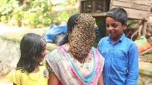 Indian woman covers face with hundreds of bees to create buzz for conservation [Video]