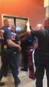 Hilarious video of firefighters rescuing police from elevator [Video]