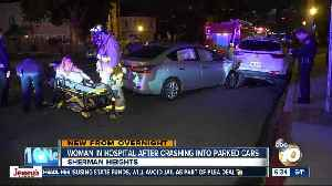 Woman hospitalized after crashing into parked cars [Video]