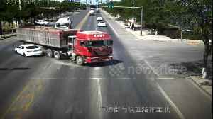 Truck driver narrowly avoids flattening car after changing directions quickly in China [Video]