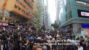 News video: Hong Kong protesters in black shirts shout 'Carrie Lam resign' at third massive demonstration