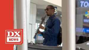 André 3000 Captured Wandering Around Airport Playing A Flute [Video]