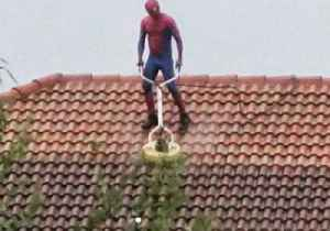 Undaunted by Pouring Rain, Spiderman Just Needs to Get This Roof Clean [Video]