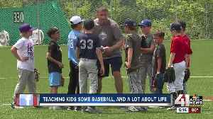Teaching kids some baseball, a lot about life [Video]