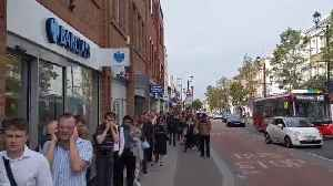 Huge queue forms outside Surbiton station during rail strike [Video]