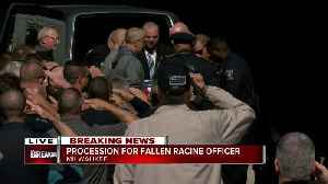 Fellow officers carry fallen officer John Hetland's body to Milwaukee County Medical Examiner's Office [Video]