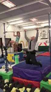 7-year-old gymnast challenges state trooper to pull-up challenge [Video]