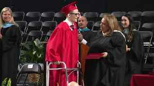 Partially-Paralyzed Student Proves Doctors Wrong, Walks Across Graduation Stage [Video]