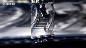 Shoppers avoid injury after steps on an escalator collapse in a Chinese mall [Video]