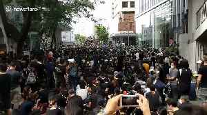 Sea of protesters block roads outside Hong Kong police headquarters [Video]