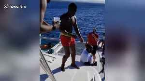 News video: A man fails miserably attempting to jump off a yacht