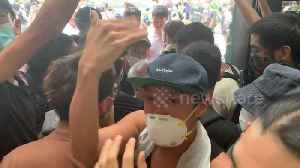 Old man quarrels with protesters inside Hong Kong's Immigration Tower [Video]