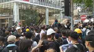 Hong Kong protesters cheer as they part ways for ambulance [Video]