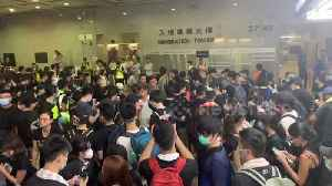 Protesters stage sit-in at Hong Kong Immigration Tower [Video]
