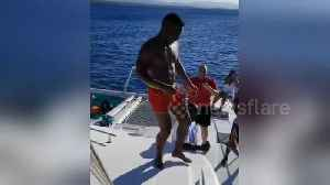 A man fails miserably attempting to jump off a yacht [Video]