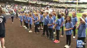 Students sign national anthem at Brewers game [Video]