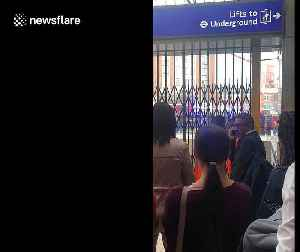 Commuters wait outside evacuated Victoria station after fire alert [Video]