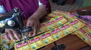 Sewing plastic waste into bags and aprons in Indonesia [Video]