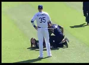 Woman Tackled After Invading Pitch to Hug Dodger's Cody Bellinger [Video]