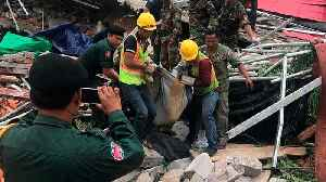 Seven-storey Cambodian collapses, killing three and trapping others [Video]