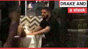 Drake spotted with a mystery woman [Video]
