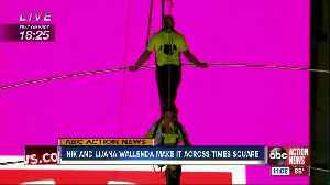Flying Wallendas safely cross Times Square on high wire [Video]