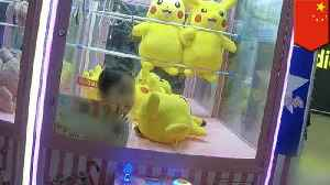 Girl gets stuck in claw machine after climbing inside for doll [Video]