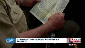 Community gathers for veteran's funeral [Video]