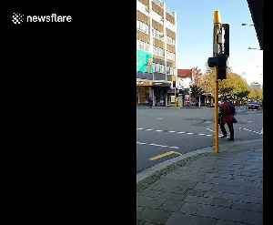 News video: New Zealand man captures moment 4 people partake in sword fight on a road