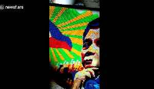 Artist creates recycled straw mural of Philippines president [Video]