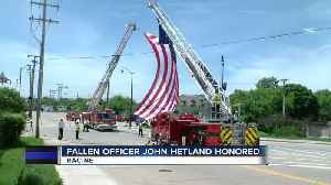 Local law enforcement honor and remember Officer Hetland day of funeral [Video]