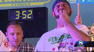 Joey Chestnut watches Steven Hendry win Santa Cruz hot dog eating contest [Video]