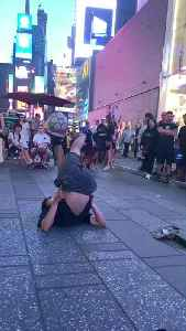 Man juggles soccer ball for crowd in Times Square [Video]