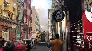 Firefighters on the scene as they attempt to extinguish flat fire in Madrid [Video]