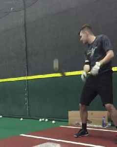 Baseball Player Flipping Bat in Style Hits his Head [Video]