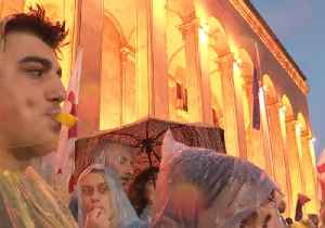 Anti-Government Demonstrators Brave Rain in Tbilisi as Protests Enter 9th Night [Video]
