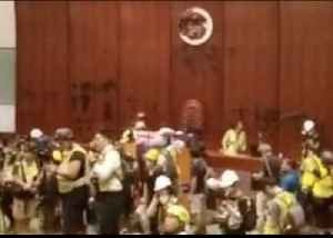 Protesters Occupy Hong Kong Legislative Building Chamber, Covering Walls in Graffiti [Video]