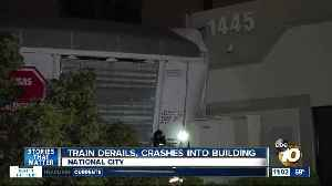 Train derails, hits building in South Bay [Video]