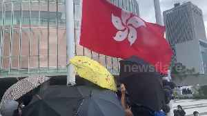 Hong Kong protesters raise black flag in front of Legislative Council [Video]