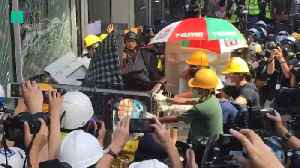 Hong Kong Protesters Smash Windows Of Government Building [Video]
