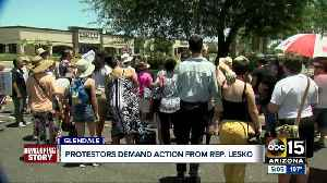 Protesters against immigration detention camps gather outside Rep. Debbie Lesko's office [Video]